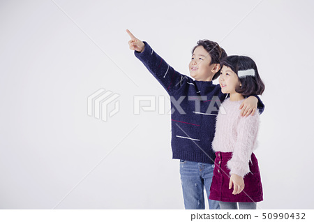 Cheerful boy and a girl on the white background 118 50990432