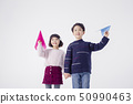 Cheerful boy and a girl on the white background 151 50990463