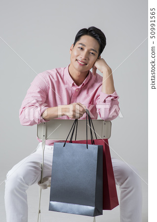 Attractive young man. sale, shopping, fashion, and style concept photo 583 50991565