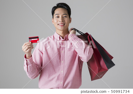 Attractive young man. sale, shopping, fashion, and style concept photo 485 50991734