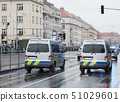 Police workers riding cars on military parade 51029601