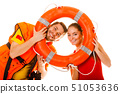 Lifeguards in life vest with ring buoy having fun. 51053636