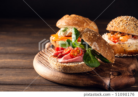Sandwiche with beef and fresh tomatoes 51098176