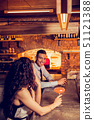 Cheerful man talking to woman meeting her in the bar 51121388