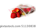 fresh strawberry in transparent open plastic bag with lock isolated on white. 51130838