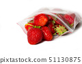 fresh strawberry in transparent open plastic bag with lock isolated on white. 51130875