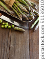 Fresh asparagus with knife 51136010