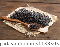 Black rice with a spoon 51138505