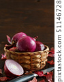 Red onions on a wooden table 51146728