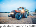 Agricultural machinery and tractor on a harvested field 51172680