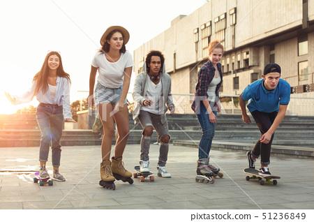 Group of teens making activities in urban area 51236849