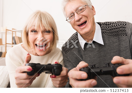Excited Middle-Aged Couple Playing Video Games, Closeup 51237413