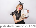 Crazy party time of beautiful women in elegant black dress with gift box celebrating birthday 51251778