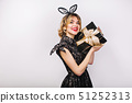 Young stylish woman on white background with gift box, celebrating, wearing black dress and black 51252313