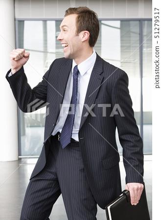 A successful job applicant or businessman making triumphal gesture 51279517