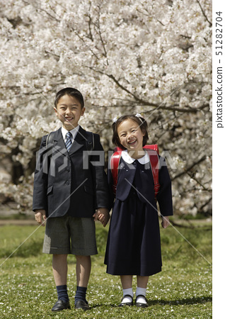 Portrait of boy and girl smiling 51282704