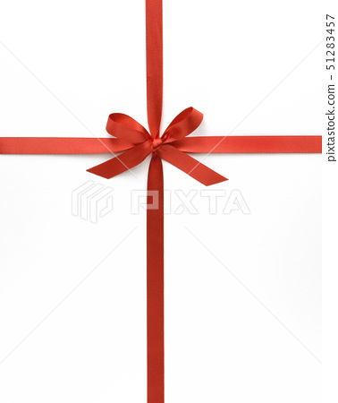 Red ribbon with bow against white background, close-up 51283457