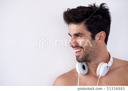 handsome young man listening music on headphones 51316883