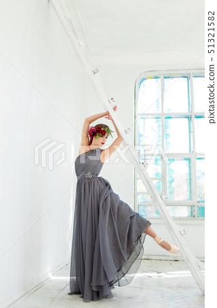The beautiful ballerina posing in long gray dress 51321582