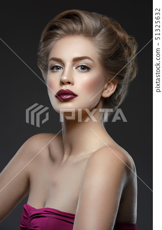Girl with dark lips and hairdo 51325632