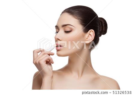 Beautiful girl applying chapstick 51326538