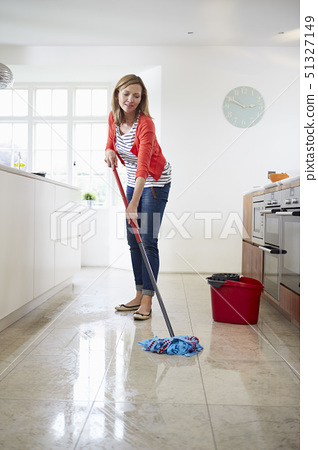 Woman Mopping Kitchen Floor 51327149