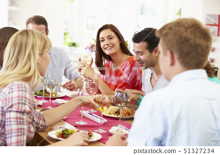 Group Of Friends Sitting Around Table Having Dinner Party 51327234