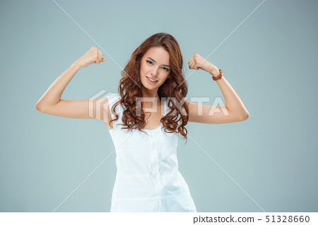 The happy woman on gray background 51328660