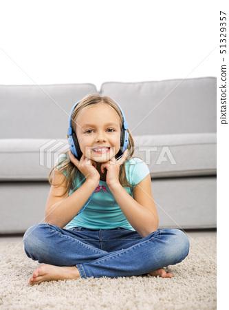 Cute girl listen music 51329357
