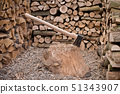 A old axe with fire wood 51343907