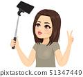 Beautiful young teenager cool girl taking a selfie 51347449