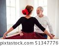 Senior couple attending dancing class in community center. 51347776
