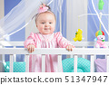 Beautiful portrait of a little girl in a pink 51347947