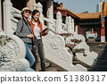 travelers walking down stairs on stone fence 51380317