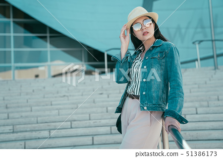 traveler leaning on city stairs railing 51386173