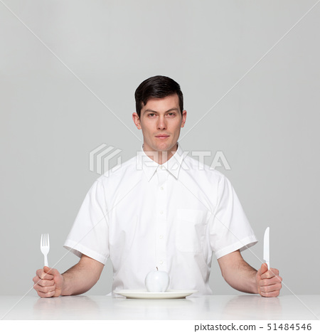 Studio portrait of young man waiting for meal 51484546