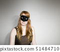 Studio shot of woman wearing mask 51484710