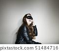 Studio shot of woman wearing mask 51484716