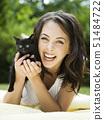 USA,Utah,Orem,Portrait of woman holding kitten 51484722