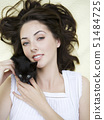 Portrait of woman holding kitten 51484725