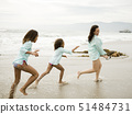 USA,California,Los Angeles,Mother with daughters (6-11) running on beach 51484731