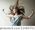 Studio shot of young woman dancing 51484741