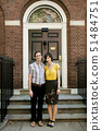 USA,New York,New York City,Portrait of young couple in front of apartment building 51484751