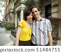 USA,New York,New York City,Portrait of young couple in front of apartment building 51484755