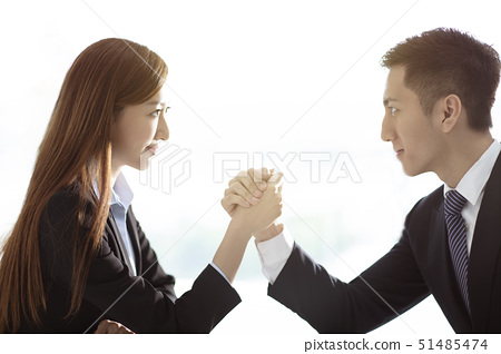 business woman VS business man arm wrestling 51485474