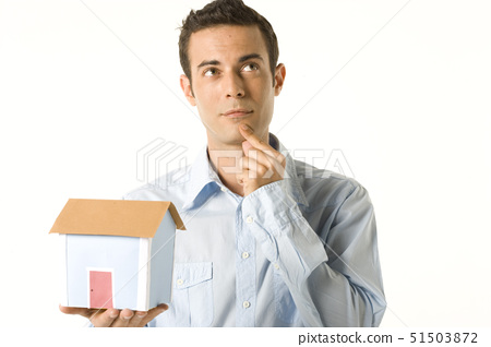 Close-up of a young man holding a model of a home 51503872