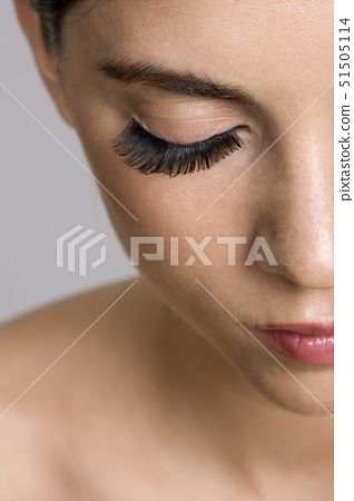 Close-up of a young woman with her eyes closed 51505114