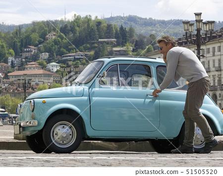 Italy, Piedmont, Turin, man entering vintage car 51505520