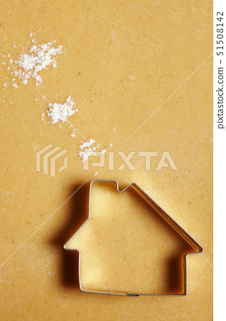 Cookie cutter house on dough with flour clouds 51508142
