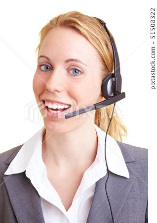Happy blond business woman using a headset 51508322